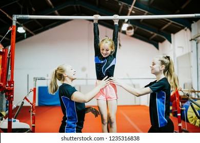 Young gymnast on a horizontal bar
