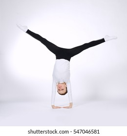 young gymnast on white background
