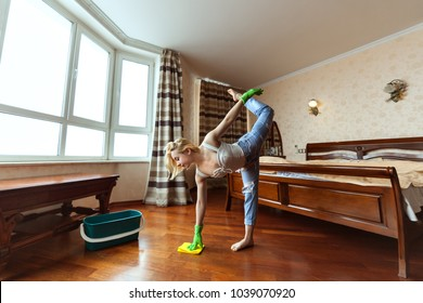 Young gymnast washes floors, she combines sports with household chores.