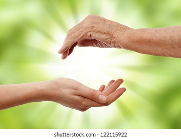 young  hand holding an older one