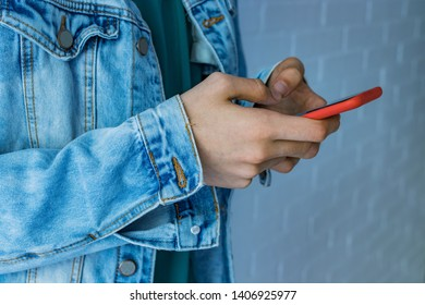 young hand with mobile phone