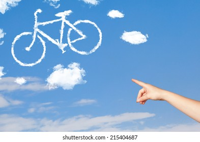 Young hand pointing bicycle clouds on blue sky