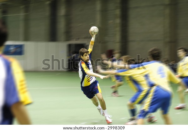 Young handball player in a match
