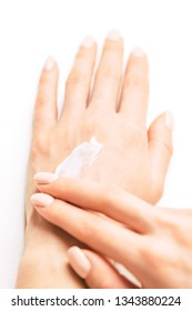 Young woman's hands applying moisturizing cream for smooth skin, concept of skincare and beauty. Point of view image.