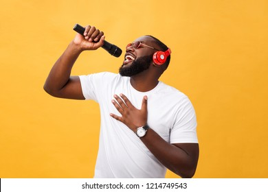 young handsome african american boy singing emotional with micro