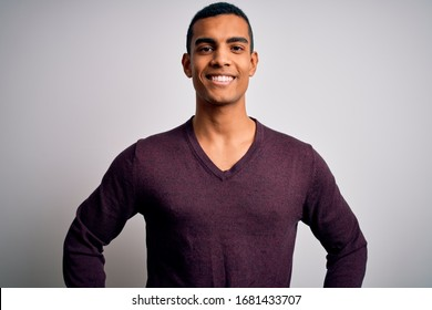 Young handsome african american man wearing casual sweater over white background with a happy and cool smile on face. Lucky person.
