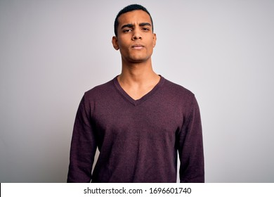 Young handsome african american man wearing casual sweater over white background depressed and worry for distress, crying angry and afraid. Sad expression.