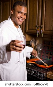 Young and handsome African American man is cooking at home.