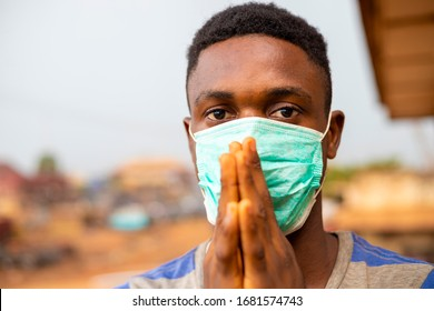 young handsome african man wore face mask preventing, prevent, prevented himself from the outbreak in his society and pleading that people show wear face mask.