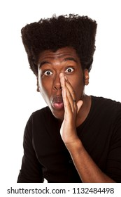 young handsome afro american hipster guy whispering isolated on white background. people gossip concept