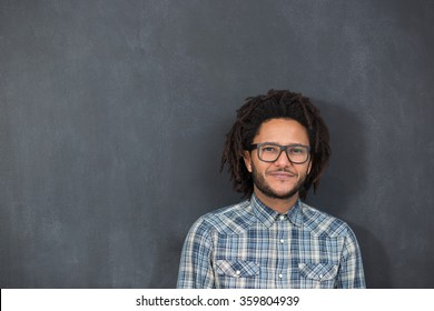 young handsome afro american man gesturing emotional posingon chalkboard, hipster on chalkboard