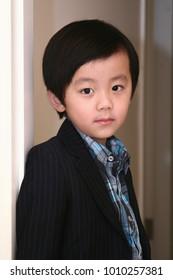 Young handsome Asian boy posing indoor