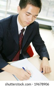 young handsome asian business man working  in office