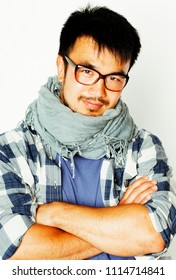young handsome asian man hipster in glasses on white background,