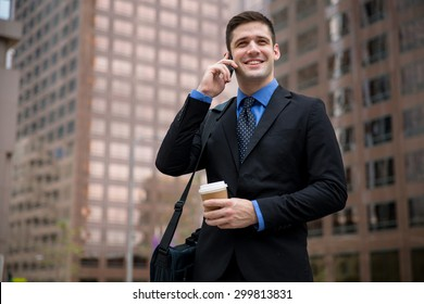 Young handsome attorney on a business call interview new job downtown skyscrapers