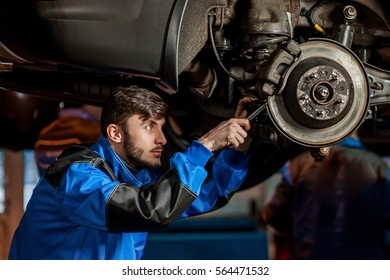 young handsome auto mechanic at work