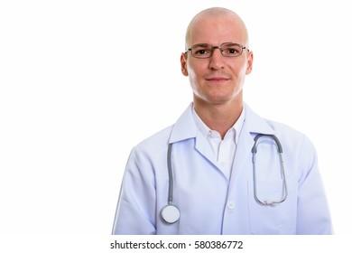 Young handsome bald man doctor wearing eyeglasses