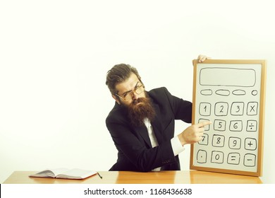 young handsome bearded man scientist or professor in teacher glasses with long beard holding board with calculator pencil and book or notepaper sitting at table isolated on white background.