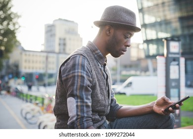 young handsome black man millennial using smart phone - technolofy, social network, remote working concept
