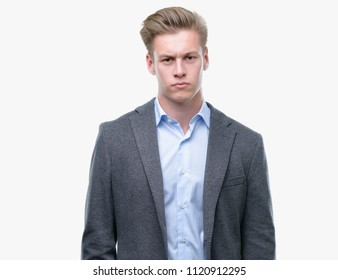 Young handsome blond business man skeptic and nervous, frowning upset because of problem. Negative person.