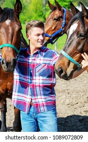 young handsome blond man with brown horses