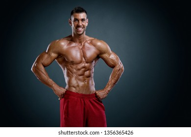 Young handsome Bodybuilder flexing muscles