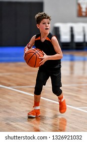Young handsome boy playing basketball
