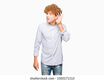Young handsome business man with afro hair wearing elegant shirt smiling with hand over ear listening an hearing to rumor or gossip. Deafness concept.