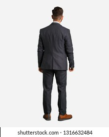 Young handsome business man from behind, looking back
