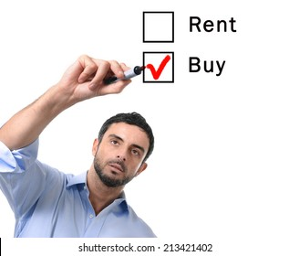 young handsome business man choosing rent or buy option at formular ticking buying box with red marker on glass isolated on white background in housing, real estate and property owner concept
