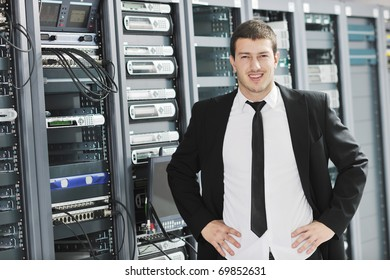 young handsome business man it  engeneer in datacenter server room