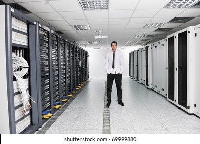 young handsome business man it  engineer in data center server room