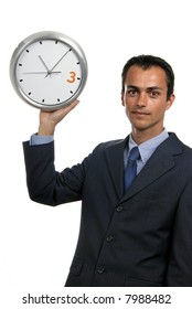 young handsome business man holding a clock