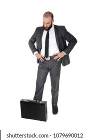 A young handsome business man standing, looking down man thinking