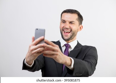 Young handsome business man taking a selfie