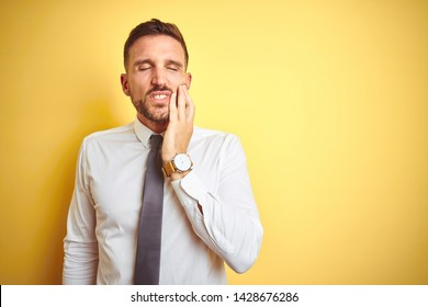 Young handsome business man wearing elegant white shirt over yellow isolated background touching mouth with hand with painful expression because of toothache or dental illness on teeth. Dentist