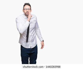 Young handsome business man wearing glasses over isolated background hand on mouth telling secret rumor, whispering malicious talk conversation