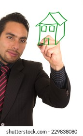 young handsome businessman drawing a house on whiteboard with marker concept of buying a house insurance investment payment future