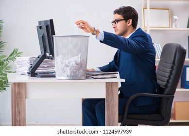 Young handsome businessman employee working in office in paperwo