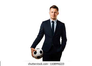 young handsome businessman holding a football isolated on white background studio. blue jacket and tie. Stylish hairstyle model. World Championship.