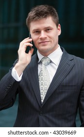 Young handsome businessman with mobile phone