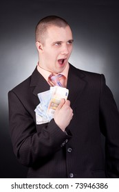 young handsome businessman with money