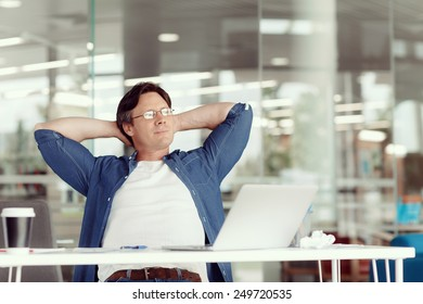 Young handsome businessman in an office having a break