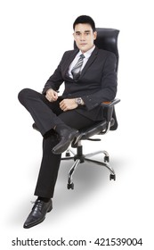 A young handsome businessman sitting on chair isolated on white background