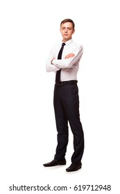Young handsome businessman is standing crossed hands. portrait isolated on white background
