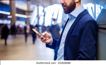 Young handsome businessman with tablet in subway
