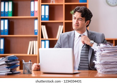 Young handsome businessman unhappy with excessive work  - Shutterstock ID 1234334431