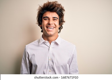 Young handsome businessman wearing elegant shirt standing over isolated white background with a happy and cool smile on face. Lucky person.
