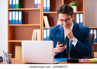 Young handsome businessman working in the office - Shutterstock ID 1259304757