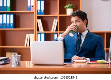 Young handsome businessman working in the office - Shutterstock ID 1388521541